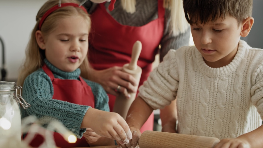 Handheld video of children making gingerbread pastry. Shot with RED helium camera in 8K. | Shutterstock HD Video #1059906272