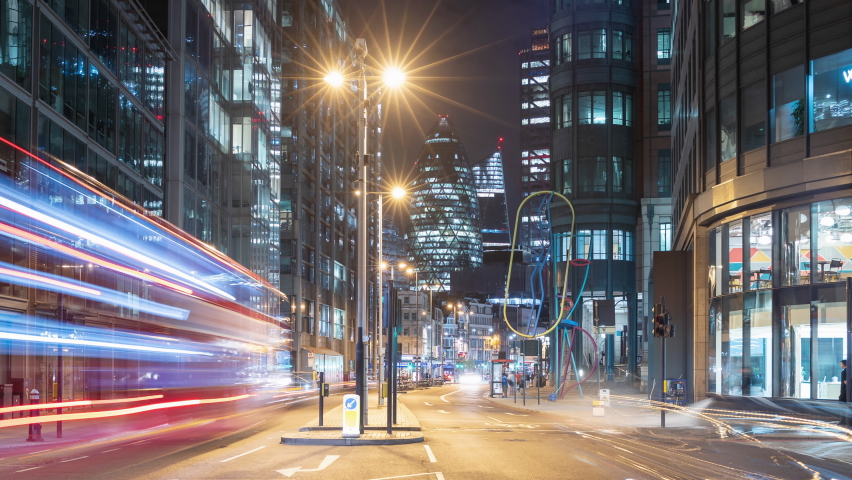 Night time lapse of a busy road in London, UK with cars and buses zooming past and famous skyscrapers in the background | Shutterstock HD Video #1059909086