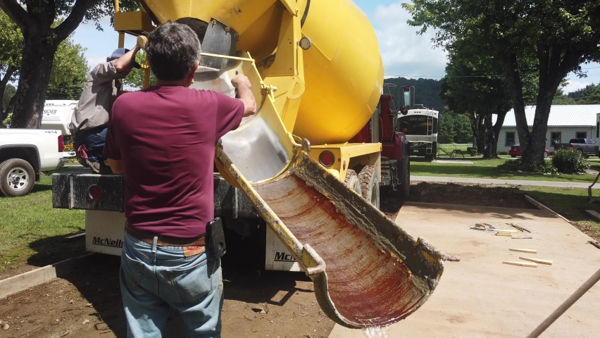 Pineola , North Carolina / United States - 09 11 2020: Spray water on chute for cement truck