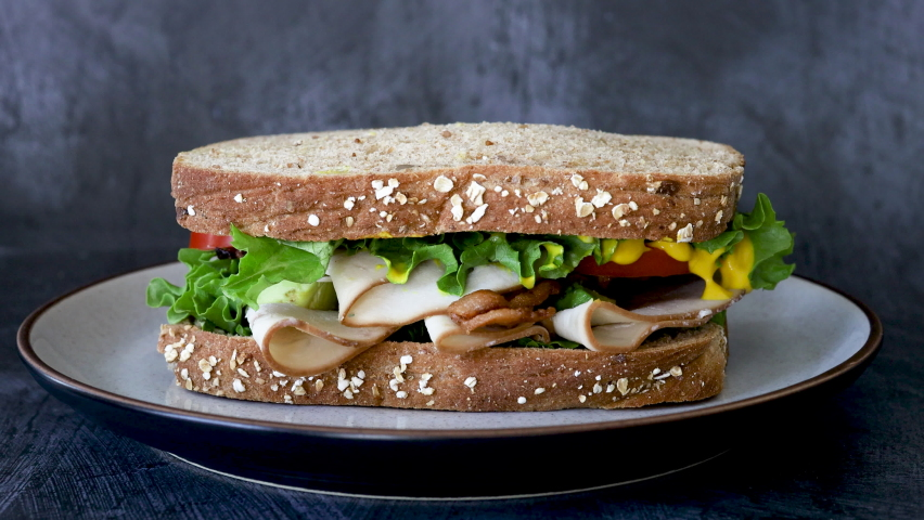 Serving a Turkey and Bacon Sandwich Royalty-Free Stock Footage #1059913580