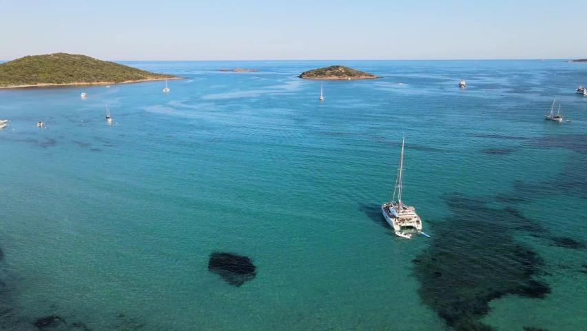 Drone shooting of the beautiful sea and boats on the beach of Pinarellu near Porto Vecchio corsica