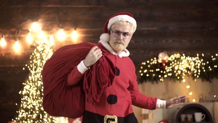 Santa Claus dancing with bag of gifts. Delivery christmas gifts. Positive human facial expressions and emotions