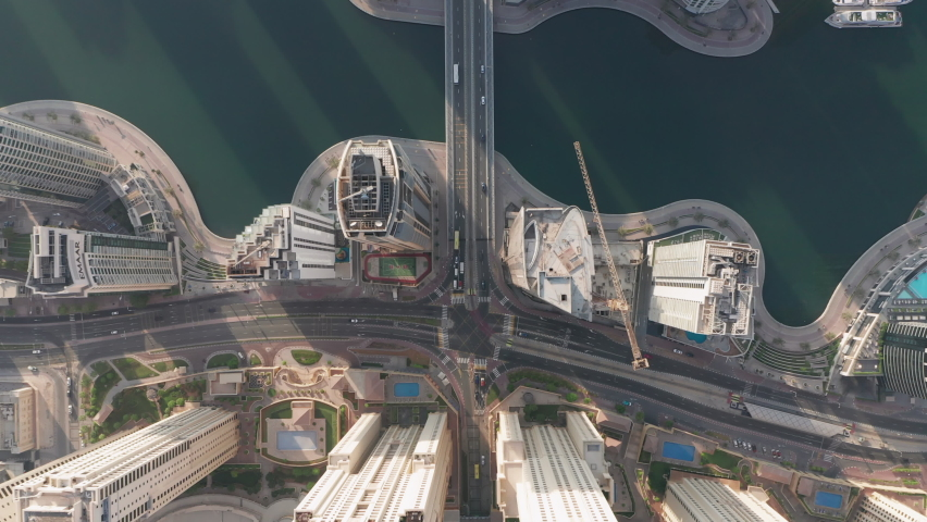 Birds eye view of Dubai city, Aerial view of futuristic Dubai Marina district with modern skyscrapers and skyline and man made lake in middle | Shutterstock HD Video #1059931154
