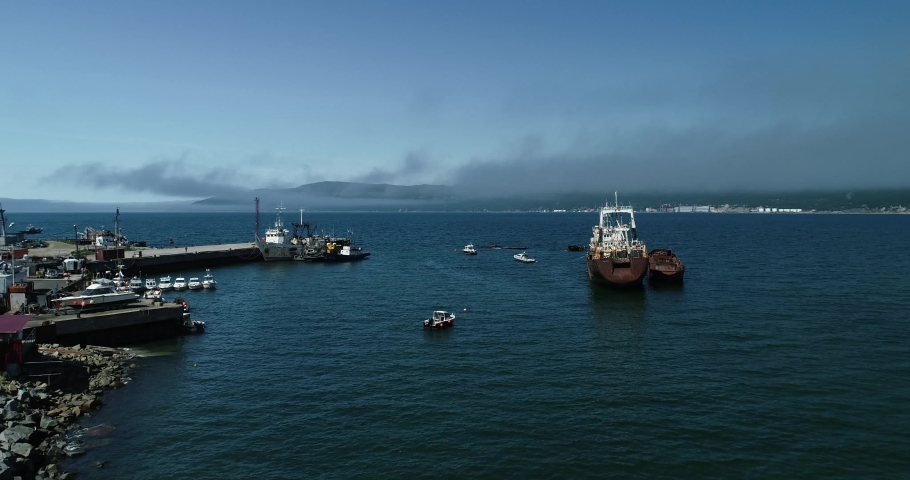 Beautiful blue sea shore. Aerial view of a broken ship. | Shutterstock HD Video #1059941891