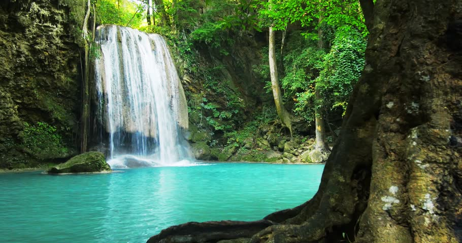 Paradise jungle forest with beautiful waterfall in green lush of Erawan park in Kanchanaburi, Thailand. Emerald pond and exotic plants