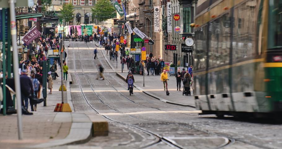 Helsinki, Finland - September 20, 2020: Aleksanterinkatu street in the center of Helsinki. The most famous street in the city. The trams moving on the street. The timelapse video.