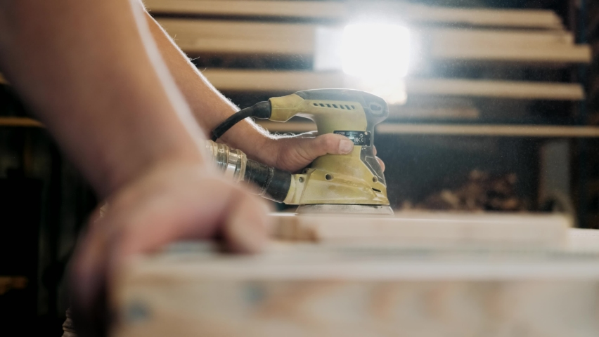 Working process in the carpentry workshop. A man Using Electric Sander for wood in a carpentry workshop.Profession, carpentry, woodwork and people concept   Shutterstock HD Video #1059957083