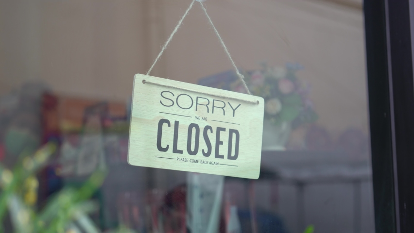 Asian woman wear mask turning Welcome we are open sign on fronton glass door cafe. Reopening activity after COVID-19, ended the lockdown and quarantine. Restarting again and keep forward concept. | Shutterstock HD Video #1059962498