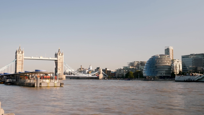 London, United Kingdom - September 21, 2020: 4K 10bit Time lapse shot of Sunset golden hour view of famous Tower Bridge and city hall in the sunlight and River Thames in London at day