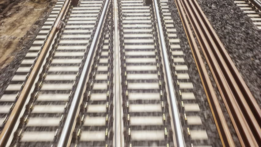 High angled shot of moving and many times crossing railroad tracks | Shutterstock HD Video #10599740