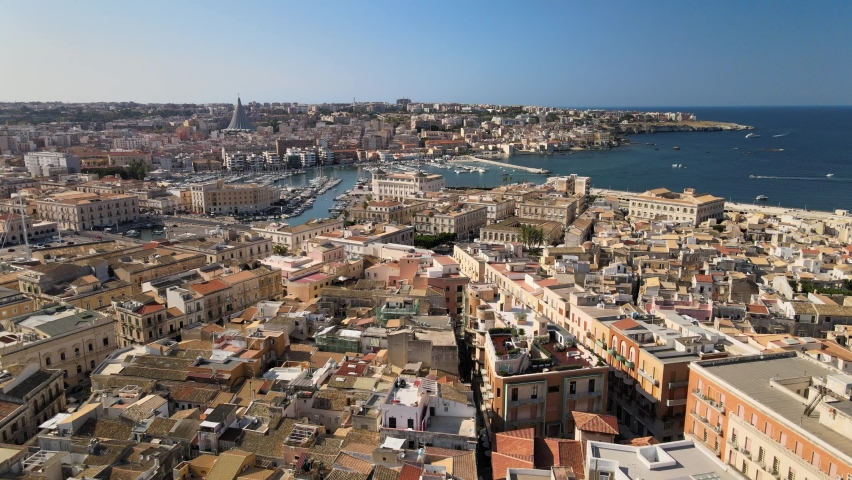 Drone flies above tthe sicilian island Ortygia (Ortigia) and harbor with boats and yachts in province of Siracusa (Syracuse) in Sicily   Shutterstock HD Video #1059987278