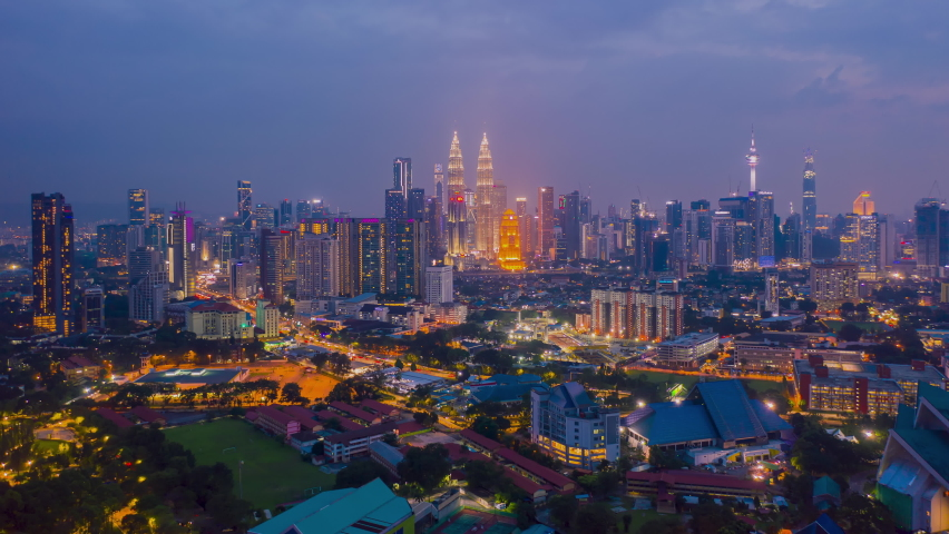 Aerial view hyperlapse 4k video of Kuala Lumpur city center view during dawn overlooking the city skyline in Federal Territory, Malaysia. | Shutterstock HD Video #1060000478