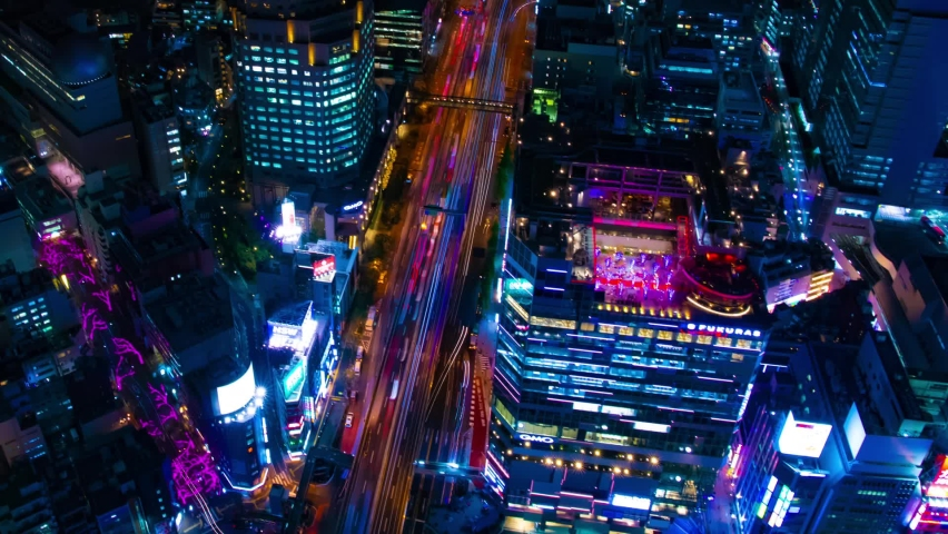 A night timelapse of the neon town in Shibuya Tokyo high angle wide shot panning | Shutterstock HD Video #1060003859