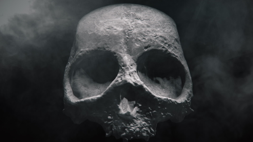 Animation of the appearance of a skull or skeleton from the darkness. Horror scene or Halloween decoration. | Shutterstock HD Video #1060018535