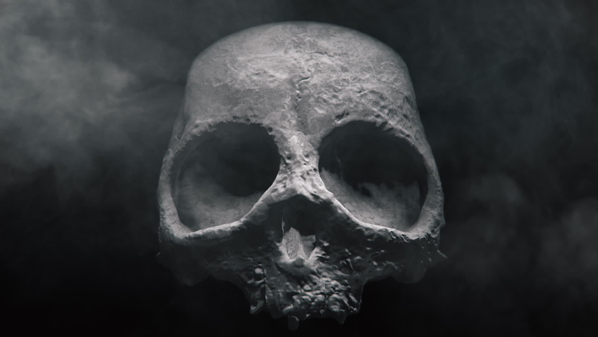 Animation of the appearance of a skull or skeleton from the darkness. Horror scene or Halloween decoration. | Shutterstock HD Video #1060018712