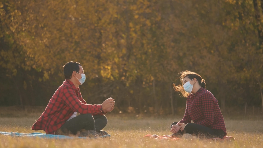 Social distance. Remote communication between people wearing safety masks.Communication during the coronavirus pandemic. New reality. Stop the epidemic with social distance. Coronavirus safety concept Royalty-Free Stock Footage #1060025312