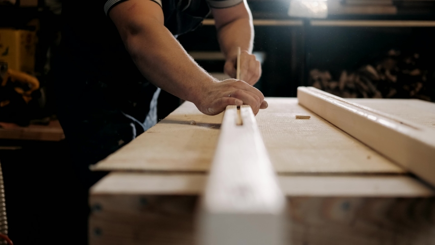 Carpenter sanding wood with sandpaper. Male hands polishing wood with sandpaper. Carpentry, craftsmanship, Handicrafts. | Shutterstock HD Video #1060042841