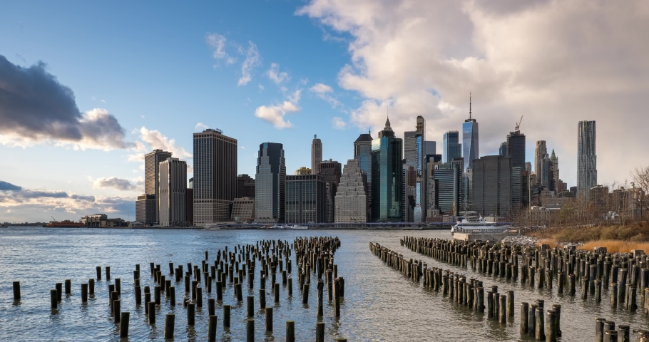 Day to Night Timelapse Sunset Over East River Lower Manhattan Skyline View From Brooklyn Bridge Park   Shutterstock HD Video #1060058144