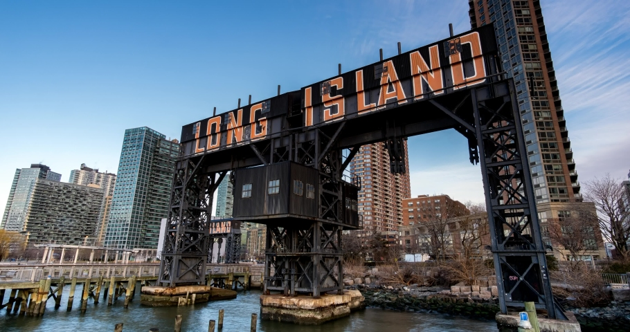 Day to Night Timelapse Sunset Over Long Island City Sign at Gantry Plaza State Park | Shutterstock HD Video #1060058180
