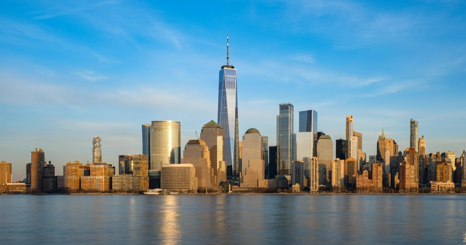 New York City - USA - Feb 17 2020: Day to Night Timelapse Sunset Clouds Moving Over Buildings in Lower Manhattan Financial District Hudson River Royalty-Free Stock Footage #1060058183