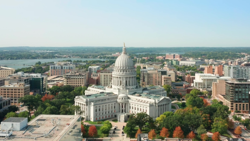 Slow drone rotation around Wisconsin State Capitol. The Wisconsin State Capitol, houses both chambers of the Wisconsin legislature, Supreme Court and the Office of the Governor. | Shutterstock HD Video #1060068521