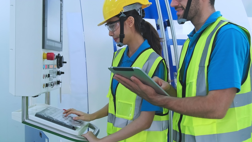 Professional engineering walking discuss inspecting with engineer team in clean room machinery factory area. Manager hand use tablet listenreport paper for internal audit.  Royalty-Free Stock Footage #1060080209