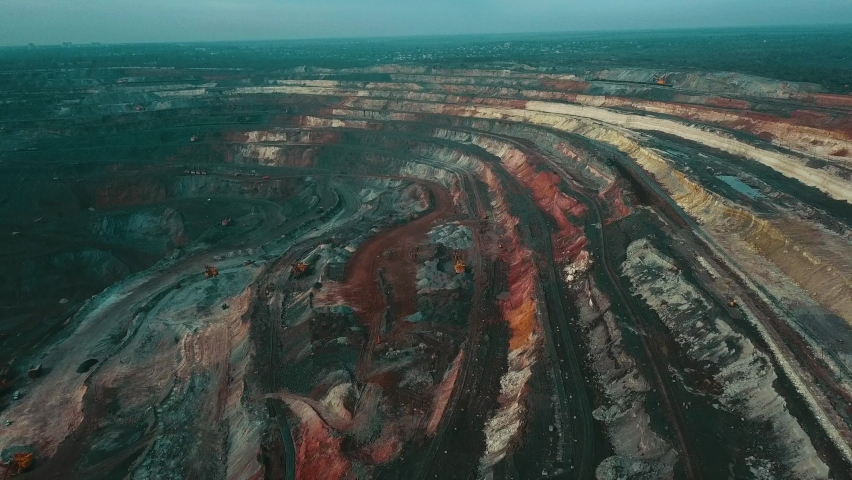 Panorama aerial view shot open pit mine coal mining, dumpers, quarrying extractive industry stripping work. Big Yellow Mining Trucks. View from drone at opencast mining with lots of machinery trucks Royalty-Free Stock Footage #1060081847