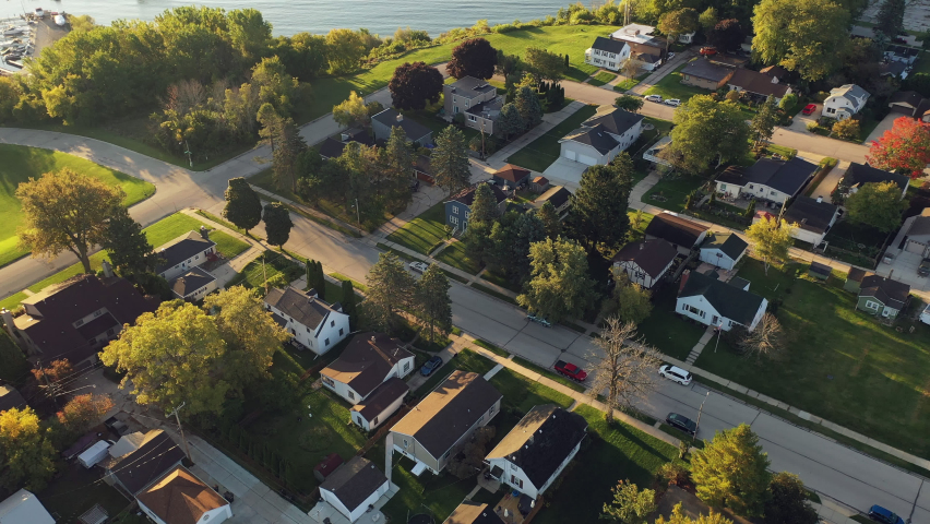 Aerial drone view of suburban neighborhood on the shoreline of Lake Michigan. Establishing shot of American suburb. Residential houses in Milwaukee, Wisconsin