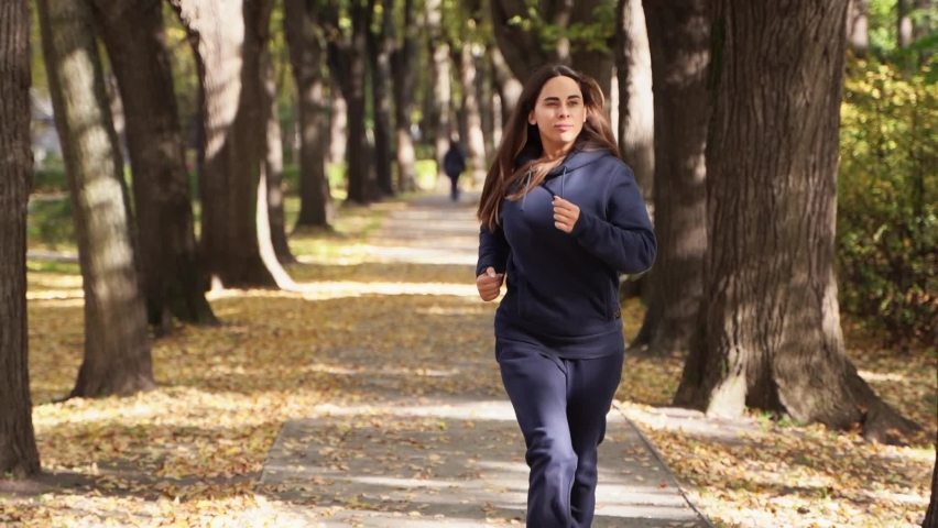 Woman runner run in the park goes for sports. runner athlete girl running on trail nature. woman on morning jog green park healthy people run park active concept. woman run sunset lifestyle silhouette