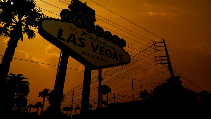 The Welcome to Las Vegas Sign at Sunset, Time Lapse with Red Sun and Fiery Sky, Nevada USA | Shutterstock HD Video #1060116062