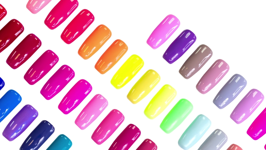 Multicolored nail Polish samples on white background isolated. Beauty banner. Trendy pattern. Nail varnish. Fashion, style. Summer manicure. Cosmetic products. Stop motion animation. Flat lay. Royalty-Free Stock Footage #1060121180