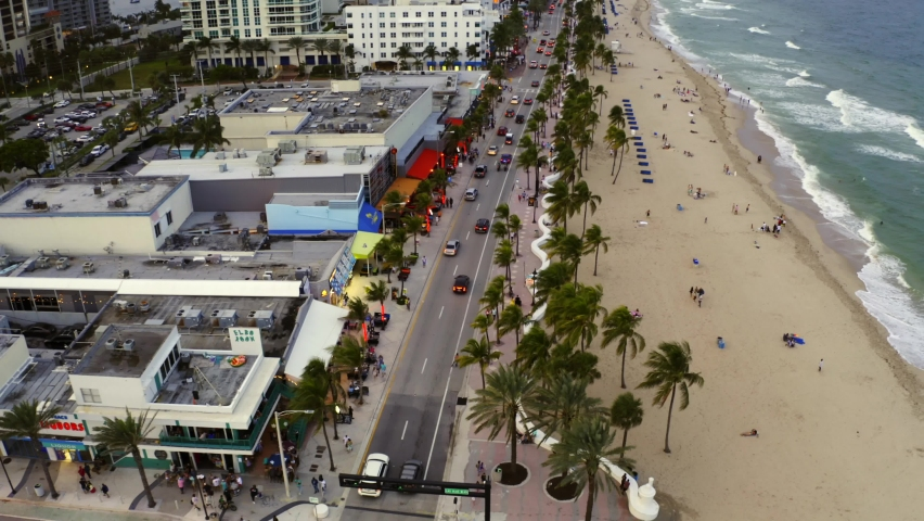 FORT LAUDERDALE, FL, USA - OCTOBER 5, 2020: Aerial pull out shot Fort Lauderdale Beach busy tourist destination   Shutterstock HD Video #1060134704