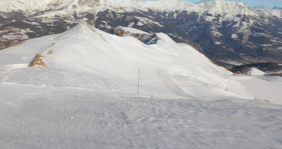 Skiing fast in the French Alps, first person point of view, descent, nobody around, empty slope | Shutterstock HD Video #1060145144