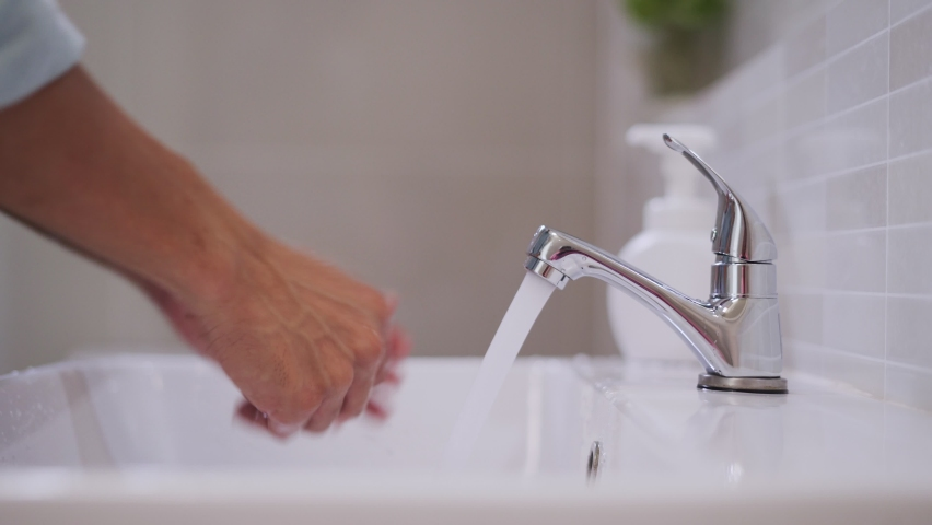 People are washing hands with foam soap and clean water. Wash your hands to keep them clean and prevent the spread of viral Royalty-Free Stock Footage #1060152614