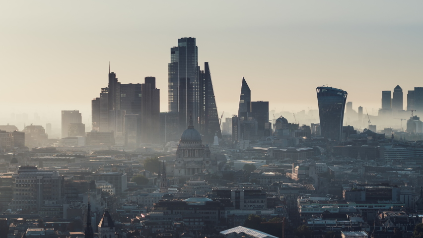 Establishing Aerial View Shot of London UK, London Skyline, St Paul's Cathedral, The City & Thames River, modern & old, United Kingdom, magical morning fog