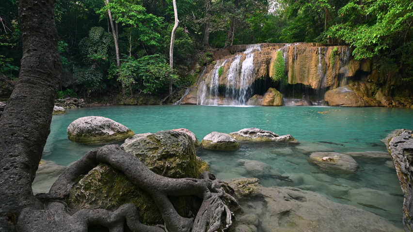 Beautiful deep forest tropical climate waterfall emerald pool of Erawan national park in Kanchanaburi province Thailand