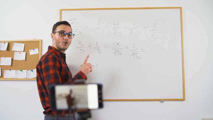 Online mathematics teacher in red shirt teaching  Royalty-Free Stock Footage #1060180199