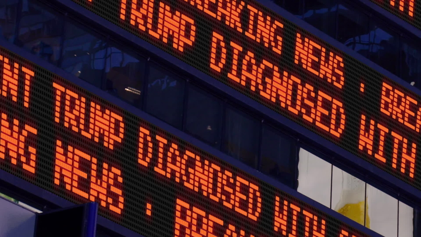 MANHATTAN - Circa October, 2020 - Closeup view of a breaking news ticker reporting that President Donald Trump has contracted COVID-19.   | Shutterstock HD Video #1060180520