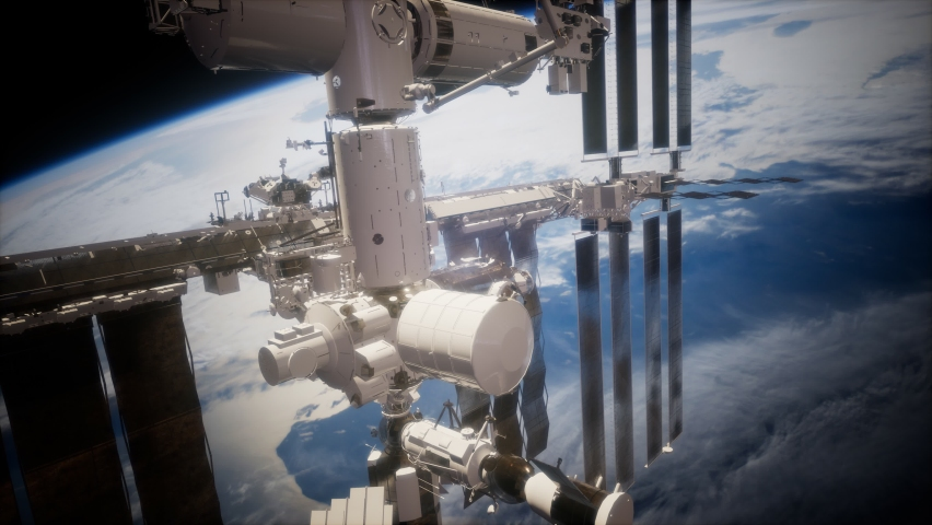 International Space Station in outer space over the planet Earth. Elements furnished by NASA. Royalty-Free Stock Footage #1060183226