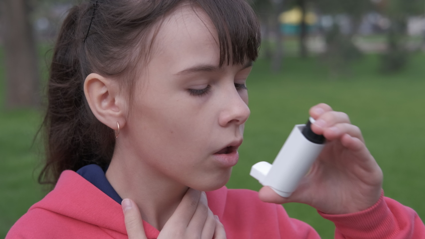 Asthmatic attack. Teenage girl is choking from asthma. Royalty-Free Stock Footage #1060189460