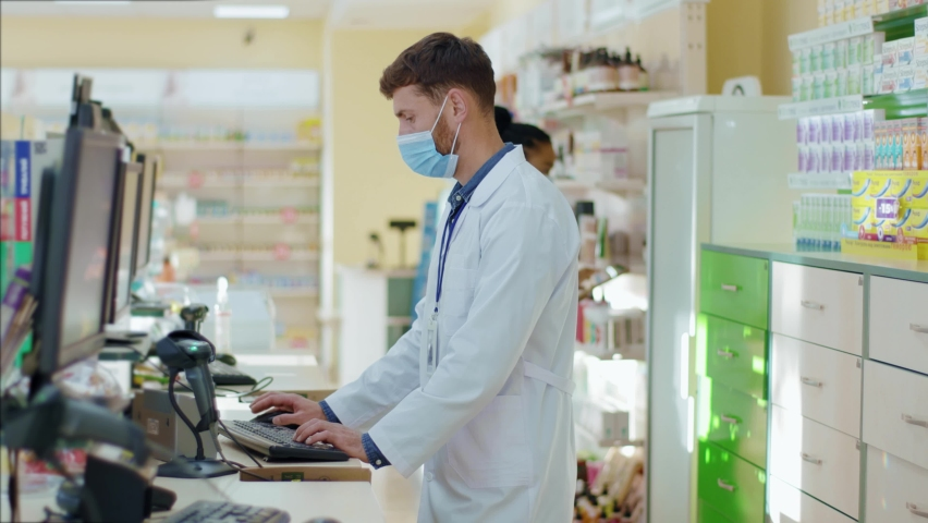 Multi-race male and female pharmacy consultants coworking in professional healthcare facilities center drugstore pharmacy indoors. Medicine concept. Coronavirus. Royalty-Free Stock Footage #1060193855