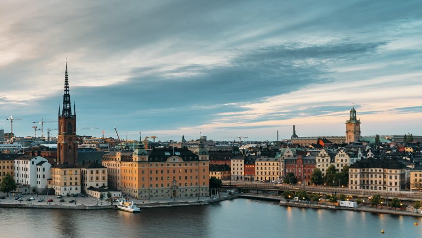 Stockholm, Sweden. Scenic View Of Stockholm Skyline At Summer Evening. Famous Popular Destination Scenic Place In Dusk Lights. Riddarholm Church In Day To Night Transition Time Lapse. | Shutterstock HD Video #1060194776