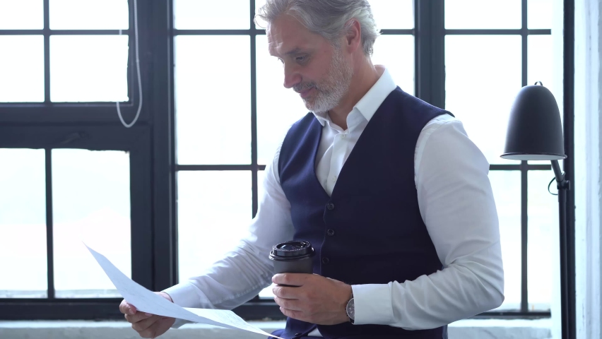 Serious businessman checking corporate paperwork correspondence Royalty-Free Stock Footage #1060207988