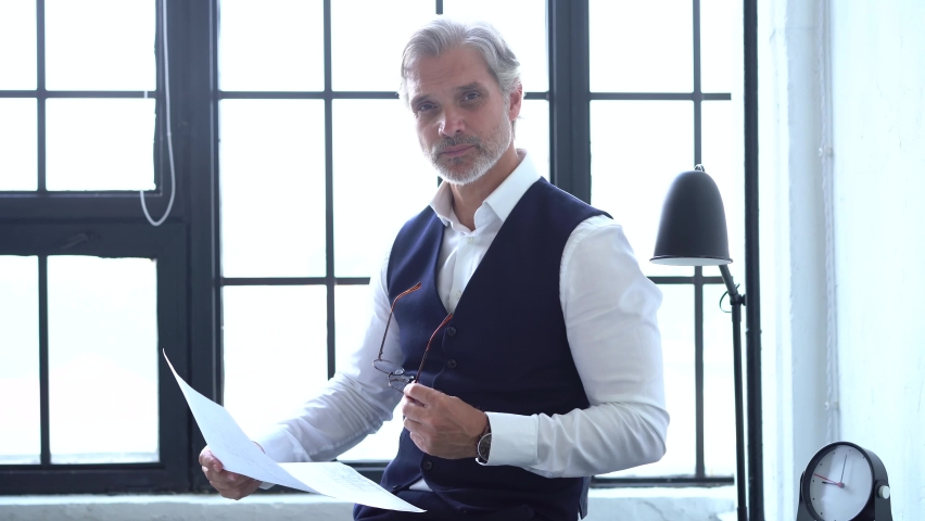 Serious businessman checking corporate paperwork correspondence Royalty-Free Stock Footage #1060207991