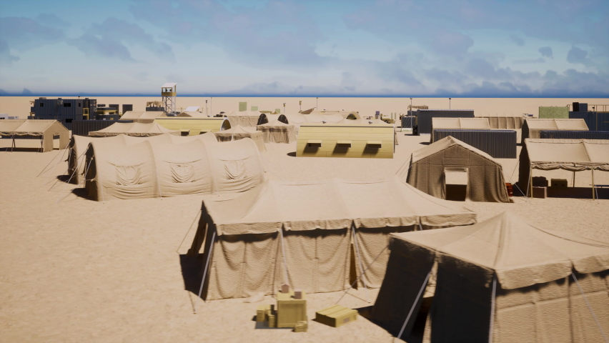 An aerial view over an abandoned army camp and training facility in the middle of the desert.