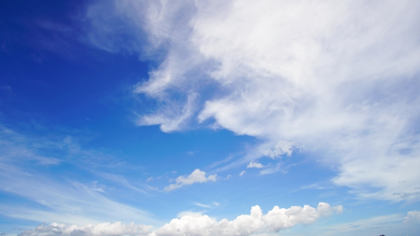4K. 4096x2304P. 29.97FPS. Time lapse, beautiful sky with clouds background, Sky with clouds weather nature cloud blue, Blue sky with clouds and sun, Clouds At Sunrise In Summer Day. Royalty-Free Stock Footage #1060213010