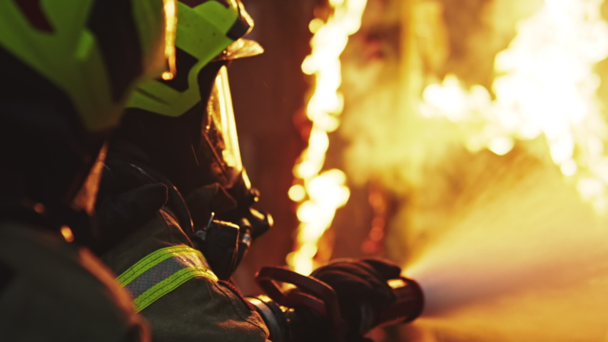 Fireman extinguish fire with the hose. Burning house fire drill. High quality 4k footage Royalty-Free Stock Footage #1060213631