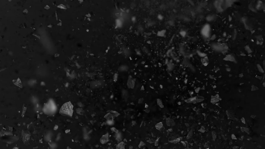 Super Slow Motion Shot of Coal Explosion Isolated On Black Background at 1000 fps.