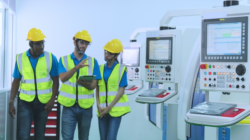 Professional engineering walking discuss inspecting with engineer team in clean room machinery factory area. Manager hand use tablet listenreport paper for internal audit.  Royalty-Free Stock Footage #1060223621