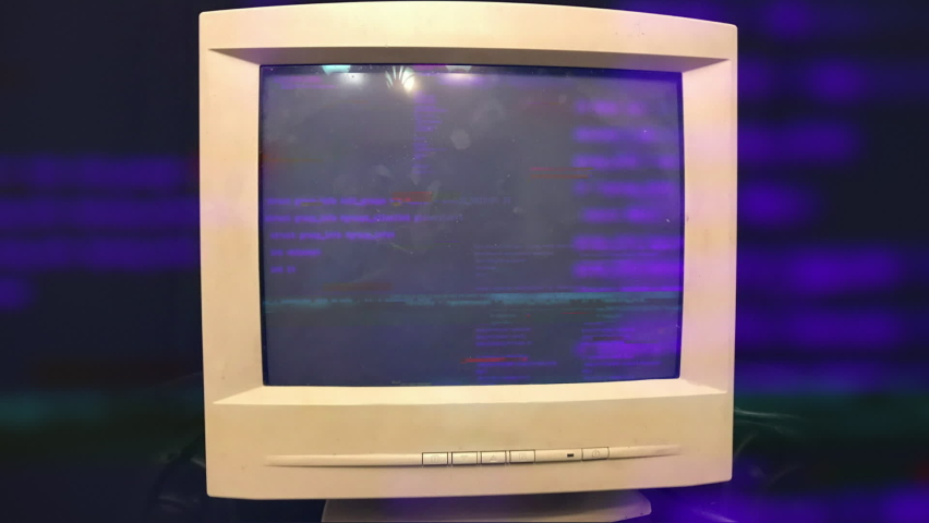 Hacking a vintage old vintage TV or computer monitor screen 80s 90s style. Glitches on screen monitor. Abstract source code data flow. Purple and blue text. screen noise. VHS style. Old kinescope | Shutterstock HD Video #1060234841